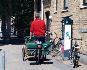 Mailman on his electric bike