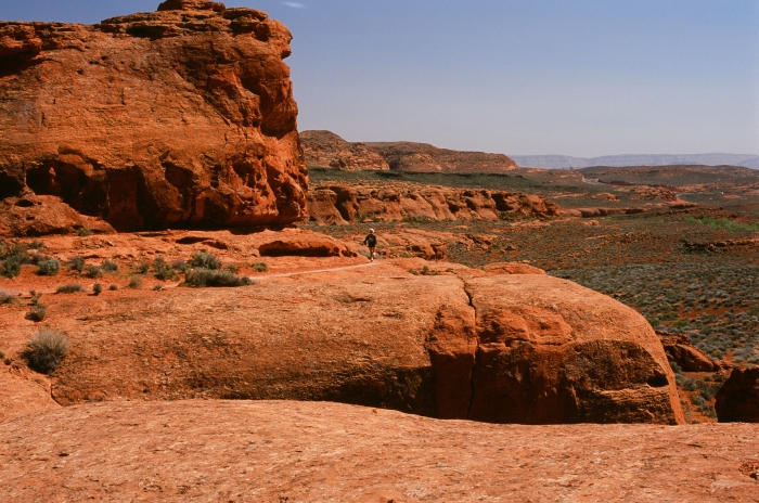 A trail runner on the Turtle Wall Trail, Desert Tortoise Preserve, St. George Utah