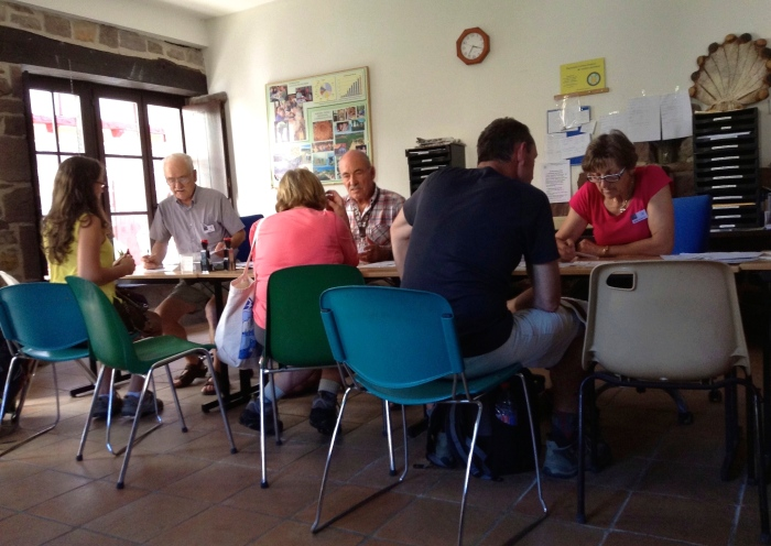 The older, white haired generation sharing their experience and knowledge of the Camino with a younger generation.