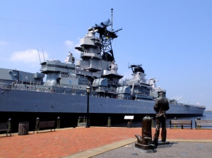 The Blue Jacket (sailor) facing the USS Missouri on  the Norfolk Waterfront
