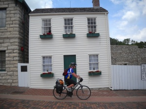 Tom Sawyers house and the famous fence with Carrie in front. She is biking along the MRT from New Orleans to Minnesota