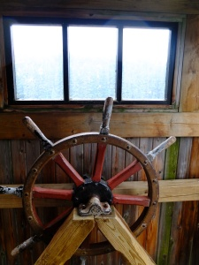In the wheelhouse of a log boat