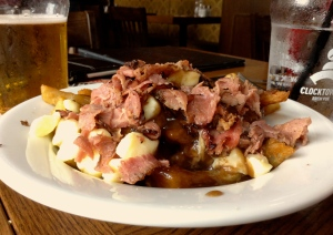 Canadian Poutine, french fries, cheese curds,bits of beef all dressed in gravy
