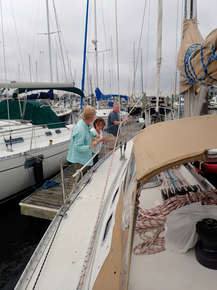 Friends come to give the skipper a bag of bagels and a push out of the slip. Norfolk Virginia