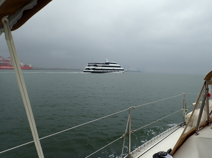 Heading into the rain with the Spirit of Norfolk on our port side.